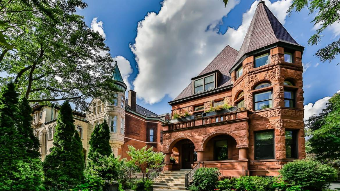 Vintage 1890s mansion in Lincoln Park, with ornate woodwork and sweeping French doors, sells …