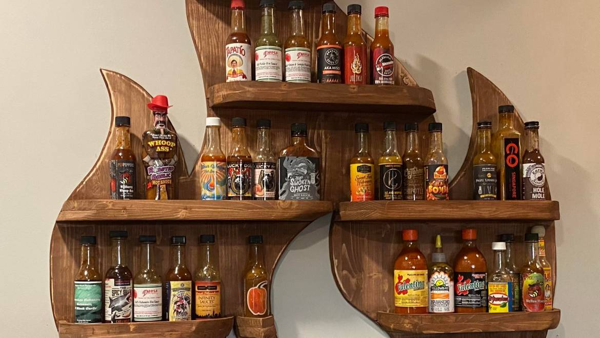 My first woodworking project. A 🔥 rack to display all of my hot sauces! : woodworking
